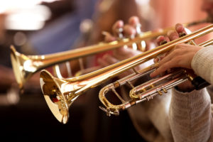 Closeup of person with braces in Milton playing the trumpet